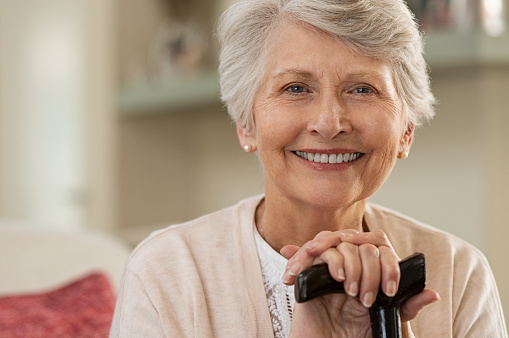 Elderly woman smiling at home 1029340842