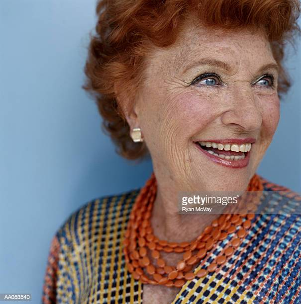 elderly woman smiling, looking away, high section - older redhead stock pictures, royalty-free photos & images