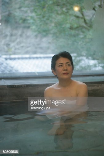 Elderly Woman Soaking In Hot Tub Stock Photo  Getty Images-4588