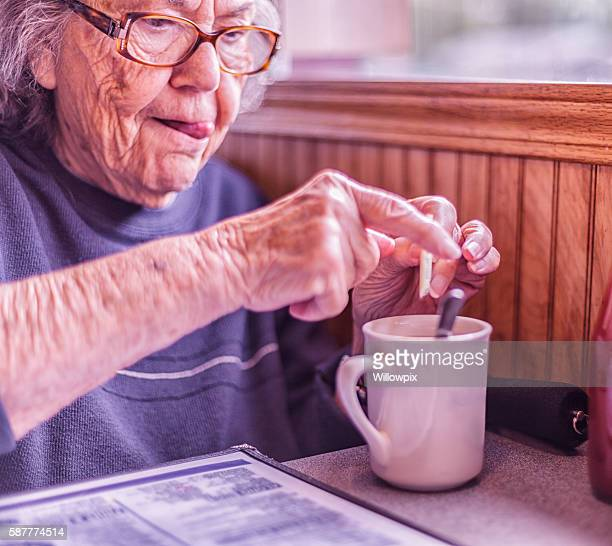 Elderly Woman Sticking Tongue Out Concentration Funny Face