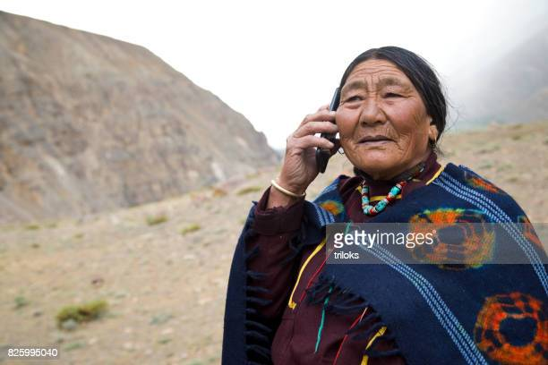 Elderly woman talking on mobile phone