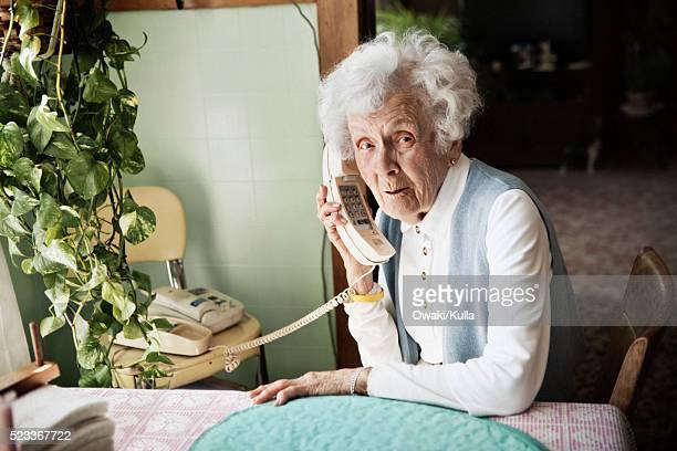 Elderly woman talking on the telephone