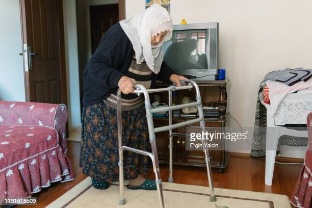 elderly woman  using  mobility walker - persons with disabilities stock pictures, royalty-free photos & images