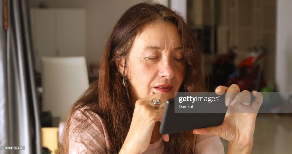 Elderly woman using smartphone : Stock Photo