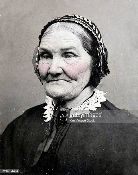 A elderly woman wearing a bonnet is shown in a 19th century tintype photograph