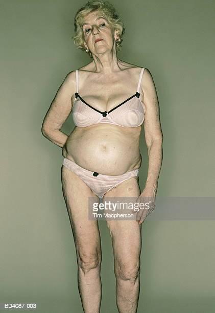 Elderly woman wearing bra and knickers, portrait
