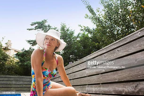 Elderly woman wearing swim suit looking away