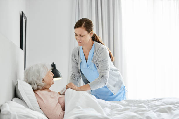 elderly woman with caregiver at home - care home stock pictures, royalty-free photos & images