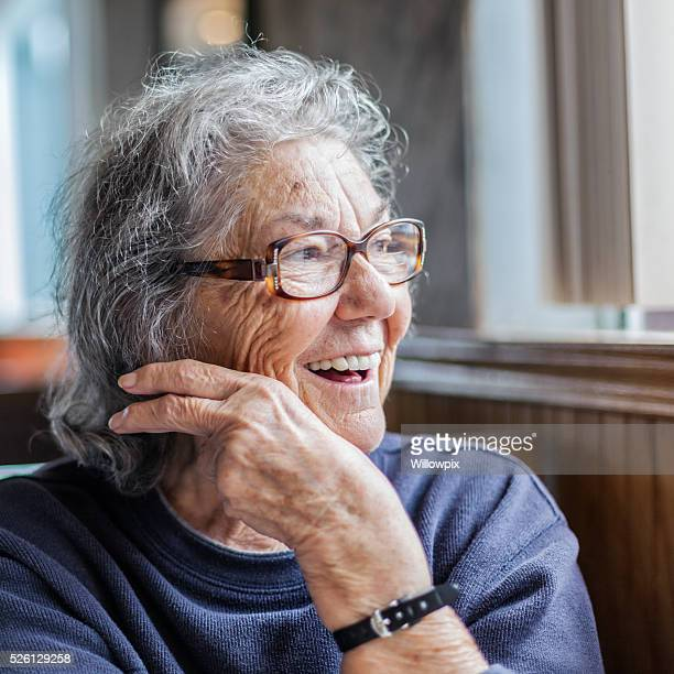 Elderly Woman With Dementia Looking Out Restaurant Window