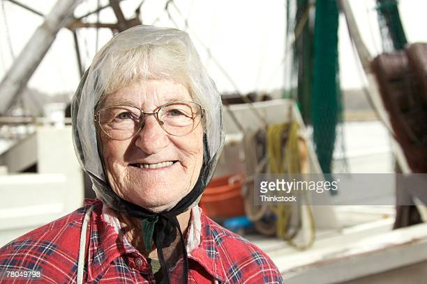 Elderly woman with fishing boat