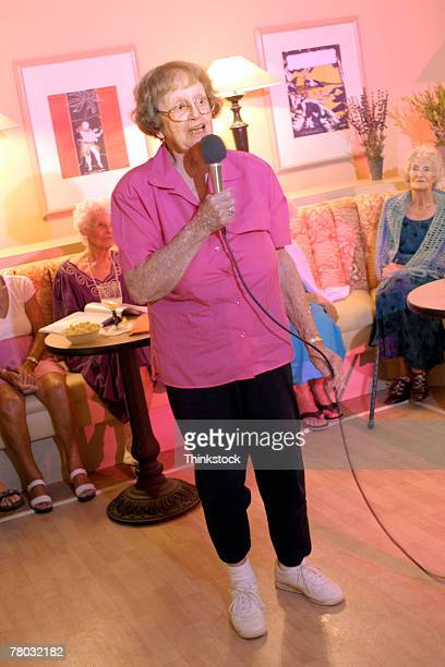 Elderly woman with microphone