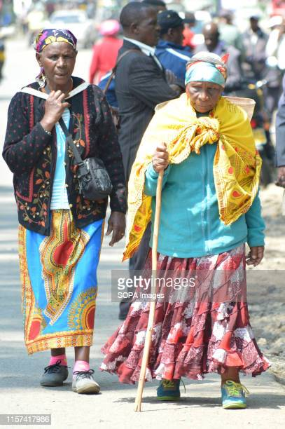 Elderly women affected by the post poll violence are seen walking after hearing of the main case seeking compensation was suspended pending...
