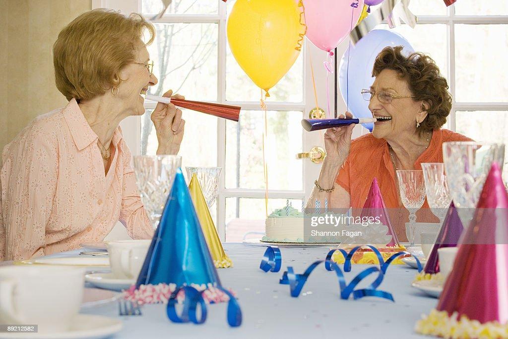 Elderly Women at Birthday Party Celebrating : Stock Photo