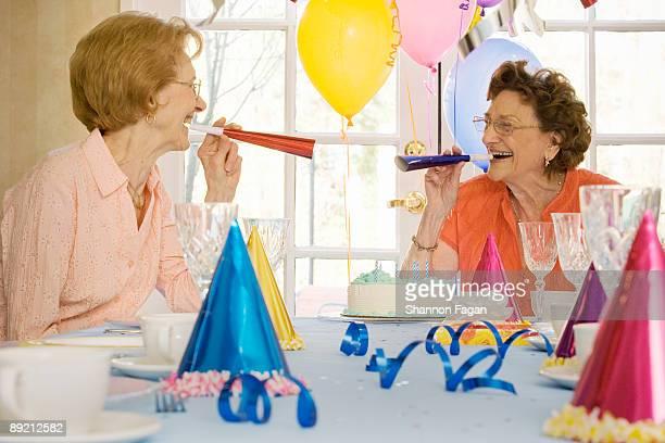 Elderly Women at Birthday Party Celebrating