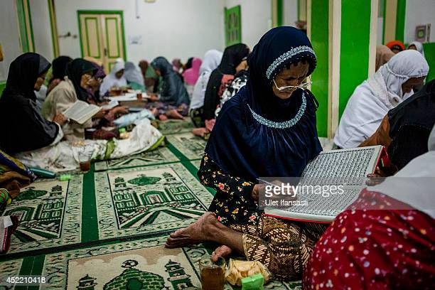 Elderly women gather as they read the Quran at a boarding school Sepuh Payaman that cares for the elderly during Ramadan on July 15 2014 in Magelang...