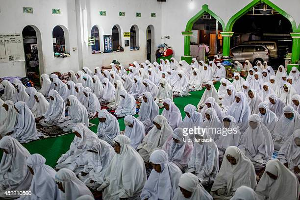 Elderly women pray at a boarding school Sepuh Payaman that cares for the elderly during Ramadan on July 15 2014 in Magelang Central Java Indonesia...