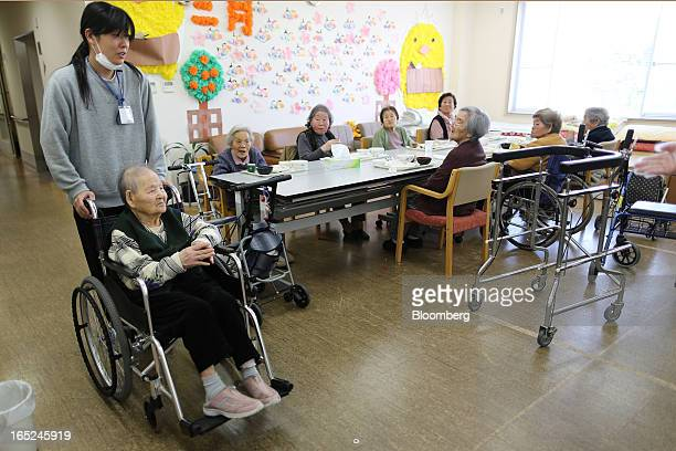 Elderly women sit at a table at a day care facility on Gogo Island in Matsuyama Ehime Prefecture Japan on Friday March 22 2013 A combination of the...
