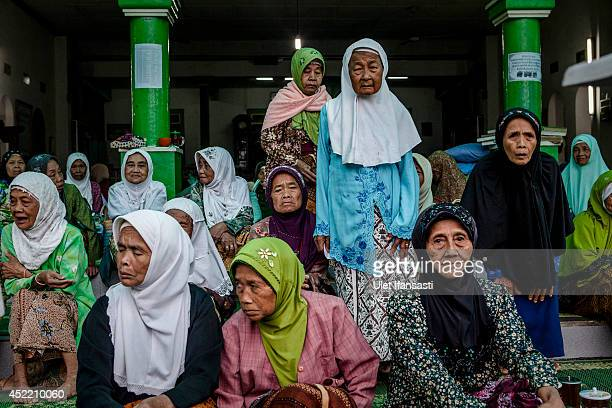 Elderly women sit together as they wait for their fasting break at a boarding school Sepuh Payaman that cares for the elderly during Ramadan on July...
