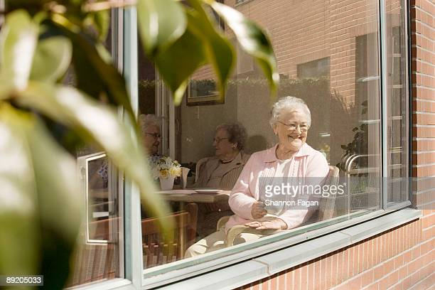 Elderly Women Sitting in Nursing Home Window