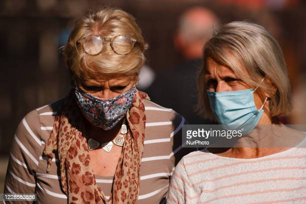 Elderly women wearing face masks walk along Piccadilly in London, England, on September 16, 2020. While the UK continues to edge towards economic...