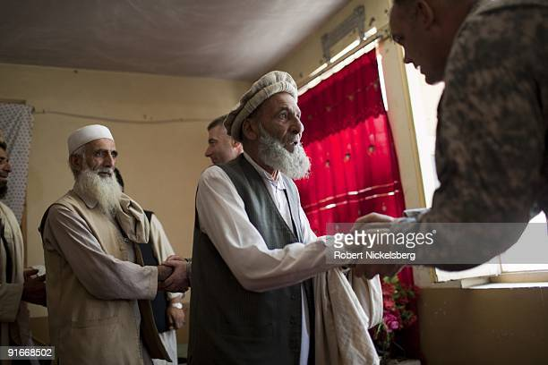 Elders from the taliban infested Shuryak Valley greet US Army's MAJ Ukia Senti right an officer with the 4th Infantry Division's 4th Brigade 2...
