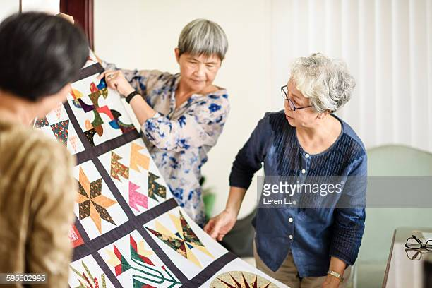 elders researching handmade patchwork - patchwork stock pictures, royalty-free photos & images