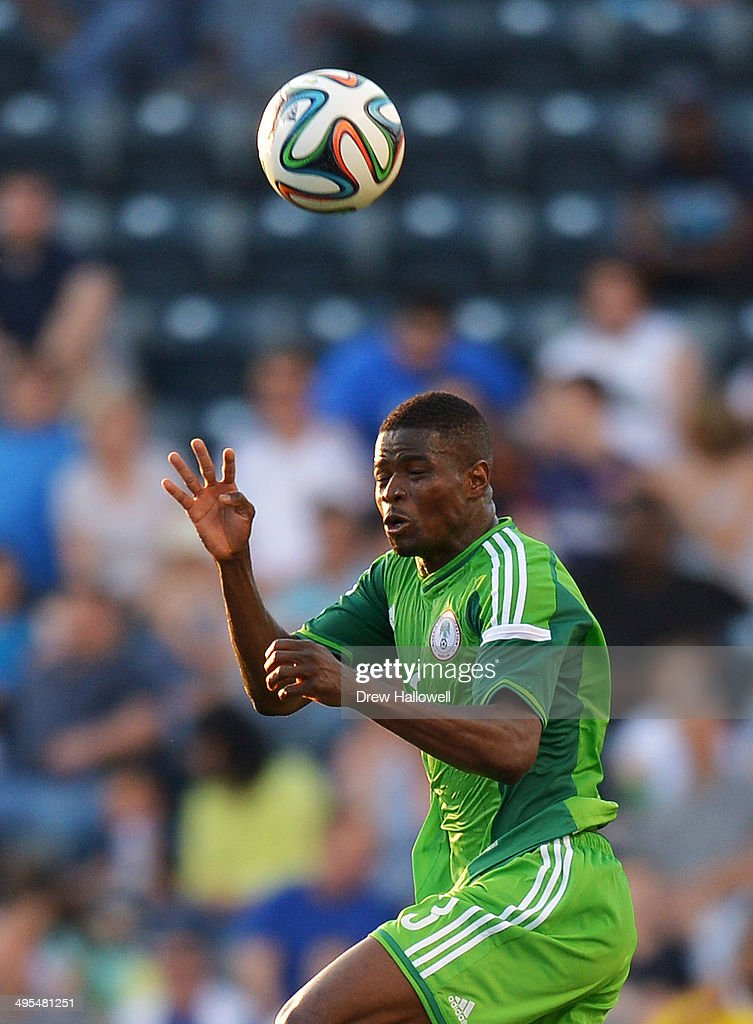 Elderson Echiéjilé #3 of Nigeria heads the ball during the match against Greece during an international friendly match at PPL Park on June 3, 2014 in Chester, Pennsylvania.