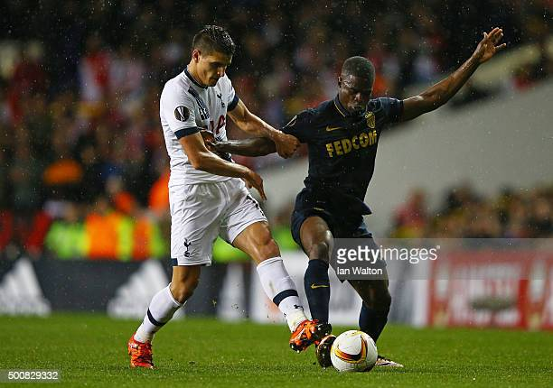 Elderson Uwa Echiejile of Monaco is challenged by Erik Lamela of Spurs during the UEFA Europa League Group J match between Tottenham Hotspur and AS...