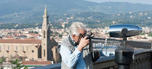eldery man has a special lens in florence - nikon stock pictures, royalty-free photos & images