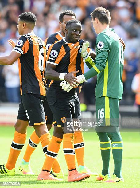 Eldin Jakupovic of Hull City and Adama Diomande of Hull City celebrate with each other after the final whistle during the Premier League match...