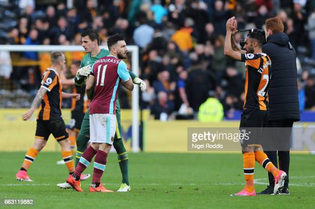 Eldin Jakupovic of Hull City and Robert Snodgrass of West Ham United embrace after the Premier League match between Hull City and West Ham United at...