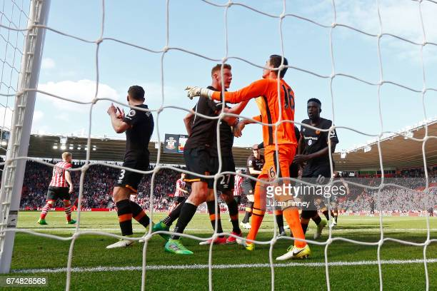 Eldin Jakupovic of Hull City celebrates with team mates after he saved a penalty taken by Dusan Tadic of Southampton during the Premier League match...