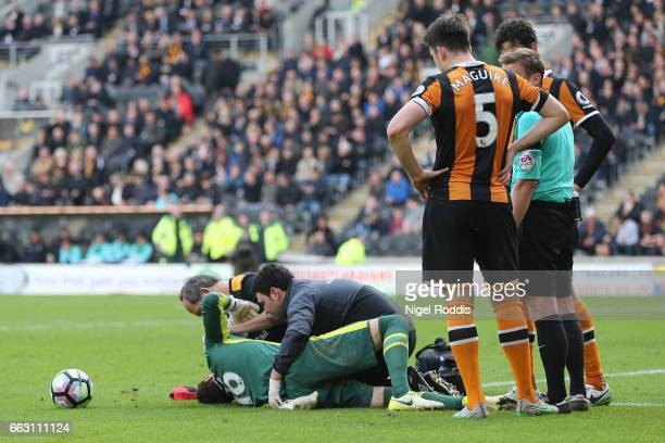 Eldin Jakupovic of Hull City receives treatment from the medical team during the Premier League match between Hull City and West Ham United at KCOM...
