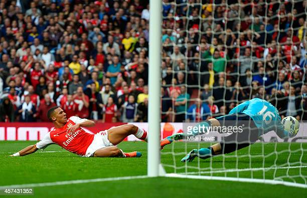 Eldin Jakupovic of Hull City saves a shot from Kieran Gibbs of Arsenal during the Barclays Premier League match between Arsenal and Hull City at...