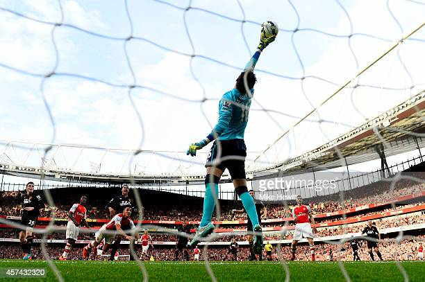 Eldin Jakupovic of Hull City saves an attempt on goal from Alexis Sanchez of Arsenal during the Barclays Premier League match between Arsenal and...