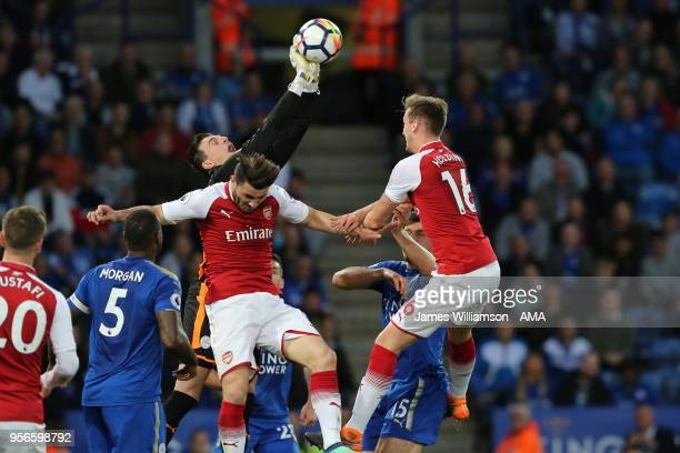Eldin Jakupovic of Leicester City clears the ball from Rob Holding of Arsenal during the Premier League match between Leicester City and Arsenal at...