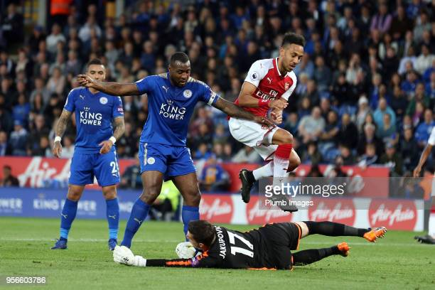 Eldin Jakupovic of Leicester City collects the ball ahead of PierreEmerick Aubameyang of Arsenal during the Premier League match between Leicester...