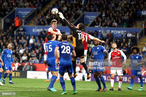 Eldin Jakupovic of Leicester City punches the ball clear ahead of Rob Holding of Arsenal during the Premier League match between Leicester City and...