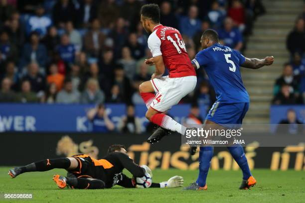 Eldin Jakupovic of Leicester City reaches the ball before PierreEmerick Aubameyang of Arsenal during the Premier League match between Leicester City...