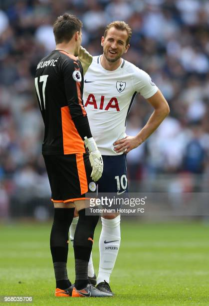 Eldin Jakupovic of Leicester City speaks to Harry Kane of Tottenham Hotspur during the Premier League match between Tottenham Hotspur and Leicester...
