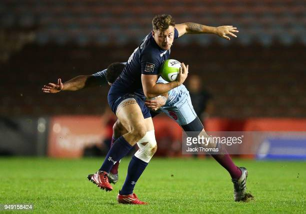 Eldon Meyers of the Royal Navy Senior XV is tackled by Sgt Lee Queeley of the Royal Air Force Seniors at Twickenham Stoop on April 20 2018 in London...