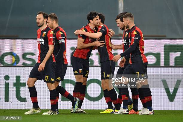 Eldor Shomurodov of Genoa CFC celebrates with teammates after scoring the first goal of his team with team mate Ivan Radovanovic during the Serie A...
