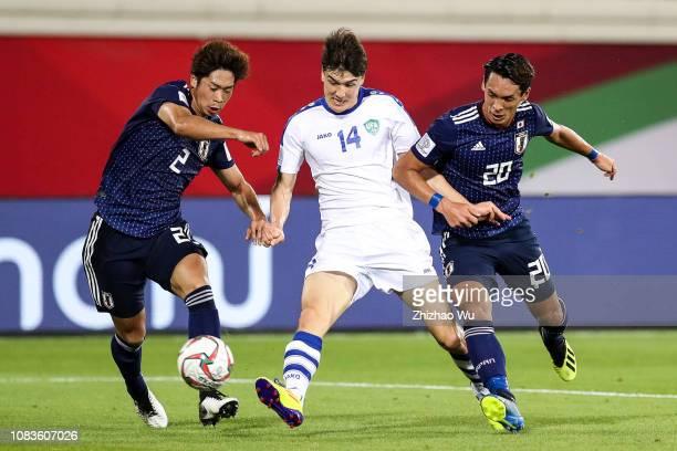 Eldor Shomurodov of Uzbekistan kicks the ball during the AFC Asian Cup Group F match between Japan and Uzbekistsn at Khalifa Bin Zayed Stadium on...