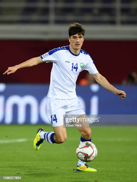 Eldor Shomurodov of Uzbekistann in action during the AFC Asian Cup Group F match between Japan and Uzbekistsn at Khalifa Bin Zayed Stadium on January...