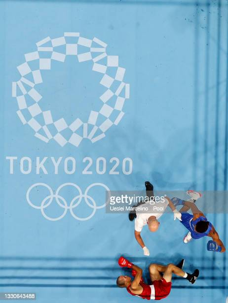 Eldric Sella Rodriguez of Refugee Olympic Team is knocked down by Euri Cedeno Martinez of Dominican Republic during the Men's Middle on day three of...