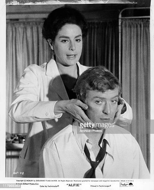 Eleanor Bron holding Michael Caine's face in a scene from the film 'Alfie' 1966