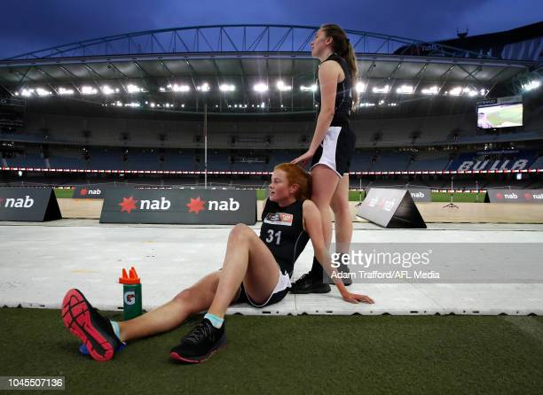 Eleanor Brown and Courtney Jones recover after the 2km time trial during the AFLW Draft Combine at Marvel Stadium on October 3 2018 in Melbourne...