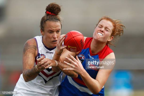 Eleanor Brown of the Bulldogs attempts to mark the ball against Mia-Rae Clifford of the Dockers during the round six AFLW match between the Western...
