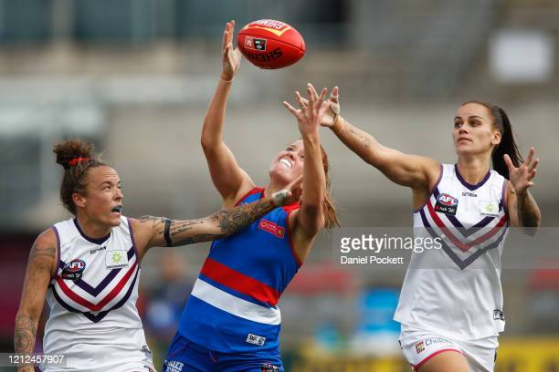Eleanor Brown of the Bulldogs attempts to mark the ball against Mia-Rae Clifford of the Dockers and Gemma Houghton of the Dockers during the round...
