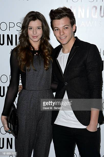 Eleanor Calder and Louis Tomlinson of One Direction attends the Topshop Unique Autumn/ Winter 2013 catwalk show at the Topshop Show Space on February...